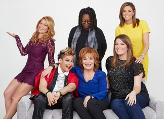 Whoopi Goldberg with co-hosts Joy Behar, Candace Cameron Bure, Michelle Collins, Paula Faris, Raven-Symone